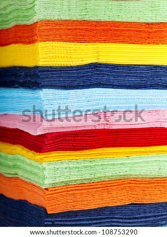 stack of colored strips paper napkins background
