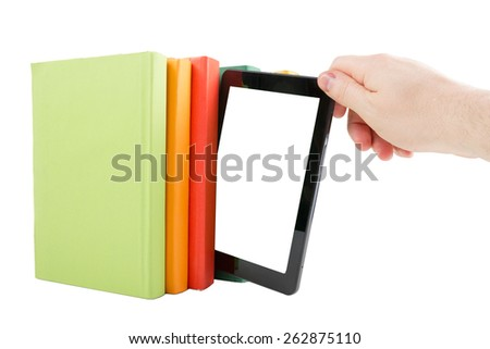 Stack of colorful books and hand holding electronic book reader isolated on white background. Electronic library concept. Back to school. Copy space - stock photo