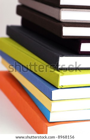 Stack of colorful books, intentional selective focus.