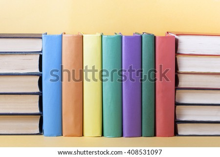 Stack of colorful books on table. Education background. Back to school. Copy space for text.