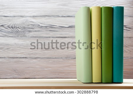 Stack of colorful books on wooden table. Back to school. Copy space - stock photo