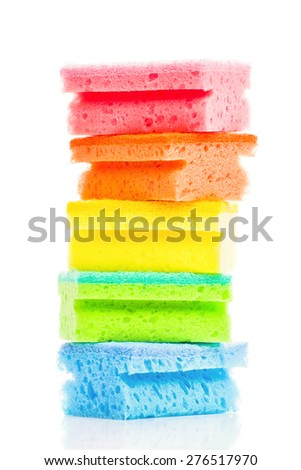 Stack of Colorful Cleaning Sponges on White Background with Reflection, Household Hygiene Equipment - stock photo