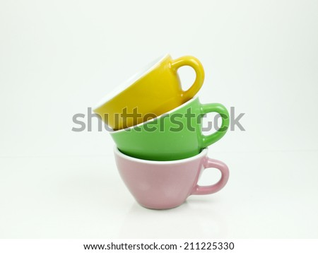 stack of colorful coffee cups isolated on white background