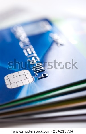 Stack of colorful credit cards and bank cards  - stock photo