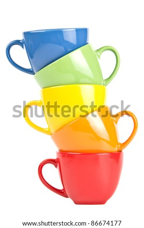 Stack of colorful cups isolated on white.