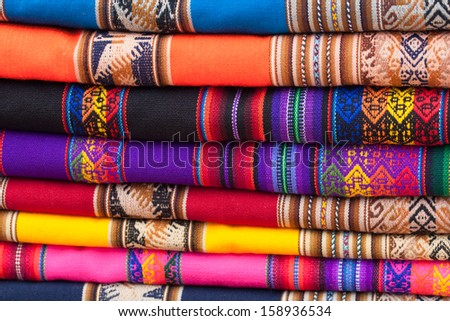 Stack of colorful fabric rags on market display in Peru, South America