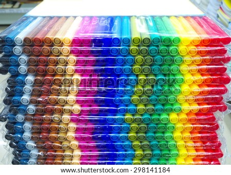 Stack of colorful felt-tips pen packs in stationery shop - stock photo
