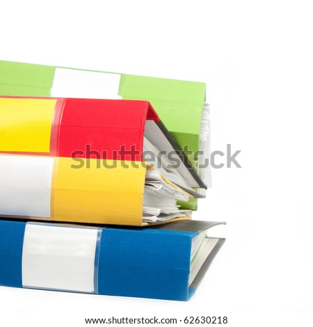 Stack of colorful folders full of papers