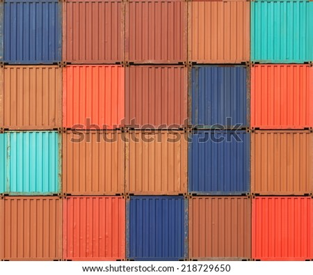 Stack of colorful freight shipping containers at the docks - stock photo