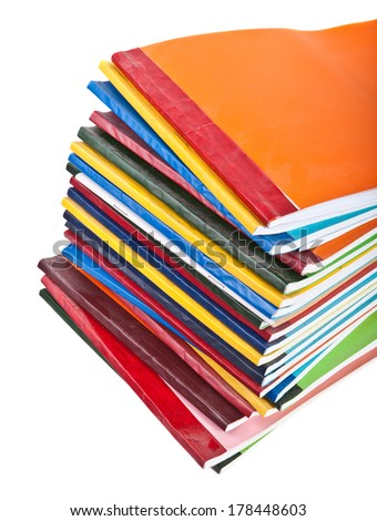 stack of colorful magazines on a white background
