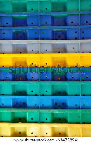 Stack of colorful plastic crates