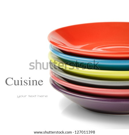 Stack of colorful plates. Menu concept - stock photo