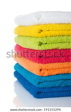 Stack of colorful towels on white - stock photo