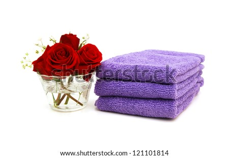 Stack of colorfull towels closeup and rose flower