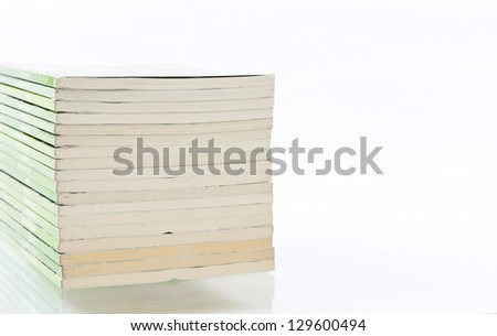 Stack of comic books isolated on white background