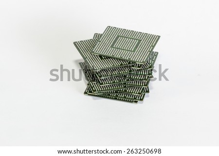 Stack of computer electronic chips isolated on white. The chips are placed upside down or facing the viewer. there are different chips in the stack - stock photo