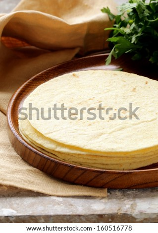 stack of corn tortillas on a wooden plate - stock photo