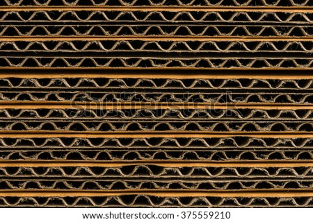 stack of corrugated cardboard boxes background. side perspective view of flattened boxes. - stock photo