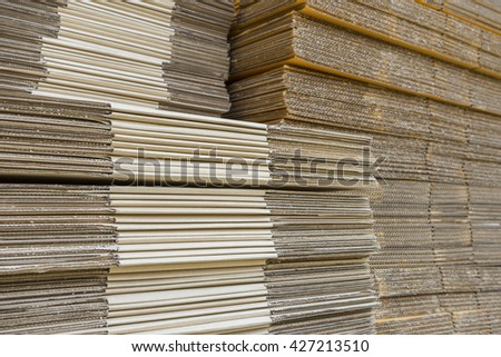 stack of corrugated cardboard boxes. egde view of flattened boxes. - stock photo
