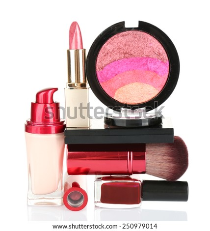 Stack of cosmetics isolated on white background - stock photo