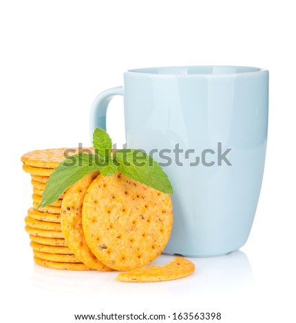 Stack of crackers with mint and cup of drink. Isolated on white ...