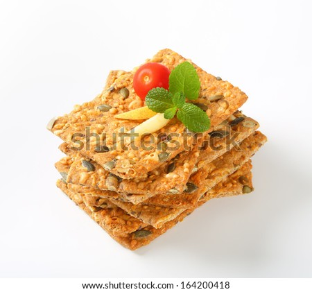 stack of crispy bread with seeds decorated with tomato and apple - stock photo