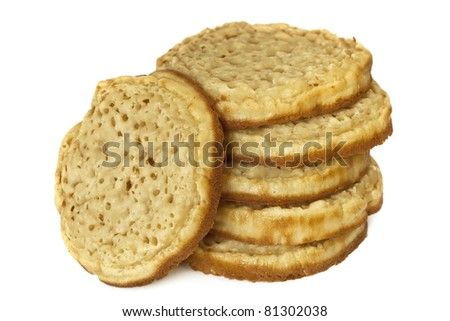 Stack of crumpets, isolated on white background.  Traditionally  English, ready for toasting.