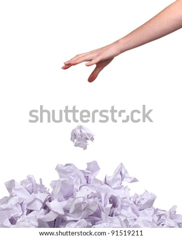 stack of crumpled paper balls and hand isolated on white - stock photo