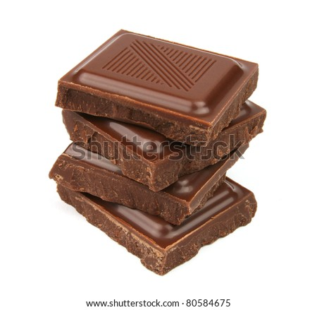 Stack of delicious chocolate pieces closeup isolated on white background