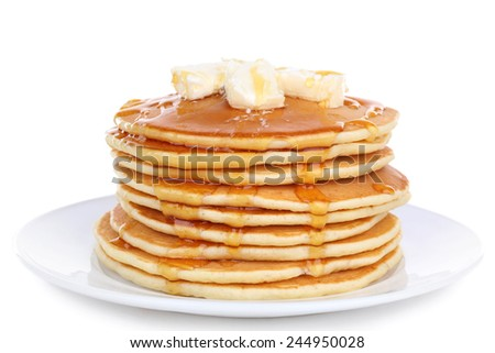 Stack of delicious pancakes with butter and honey isolated on white - stock photo