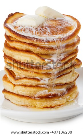Stack of delicious pancakes with butter on plate isolated on white background.