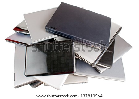 Stack of different  laptops, upper view, isolated on white - stock photo
