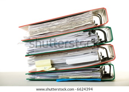 Stack of documents in binders against white background. Office life.
