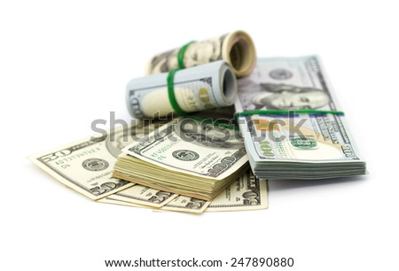 Stack of dollars bills on white background - stock photo