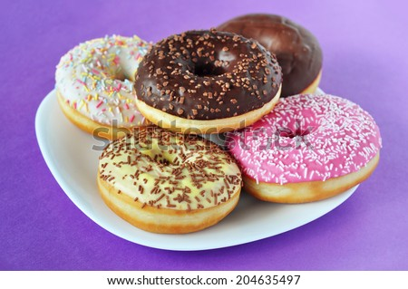 Stack of doughnuts on a plate