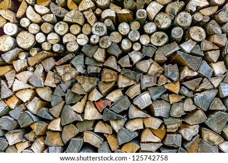 Stack of dried firewood of pine wood - stock photo