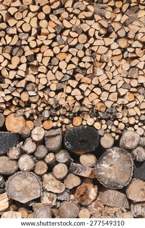 Stack of dry chopped firewood, wood texture - stock photo