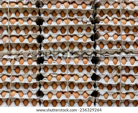 Stack of eggs in a shop - stock photo