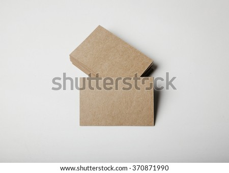 Stack of empty craft business cards on white background with soft shadows.  - stock photo