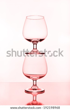 stack of empty wine glass on glass table