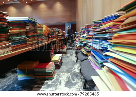 stack of envelops on desks and chairs - stock photo