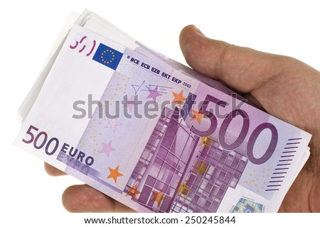 Stack of 500 euro in hand on white - stock photo