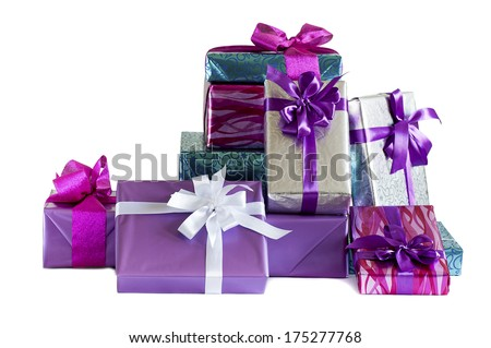 stack of festive gift boxes isolated on white background - stock photo