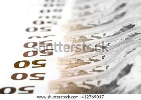 Stack of fifty euro bills stacked in a row. european currency economic concept.