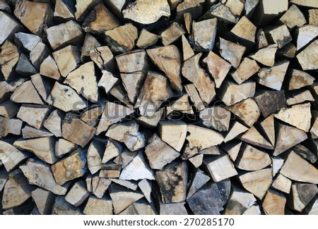 stack of firewood chopped into pieces - stock photo