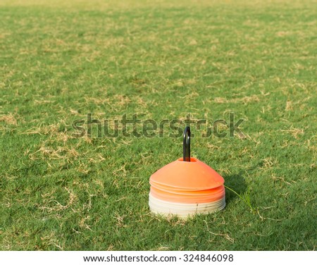 stack of flat marker cone in football field,sport equipment - stock photo