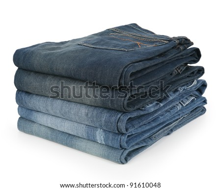 Stack of Folded Jeans in Various Shades of Denim - stock photo