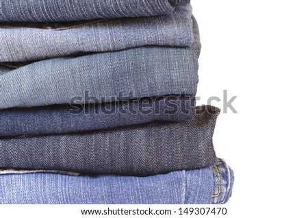 stack of folded jeans on white background - stock photo