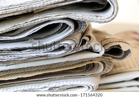 stack of folded newspapers - stock photo
