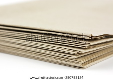 Stack of folded up brown parcel paper - stock photo